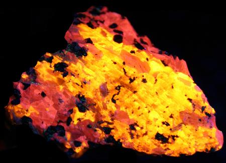 Fluorescent 3rd Find wollastonite in calcite under shortwave UV light