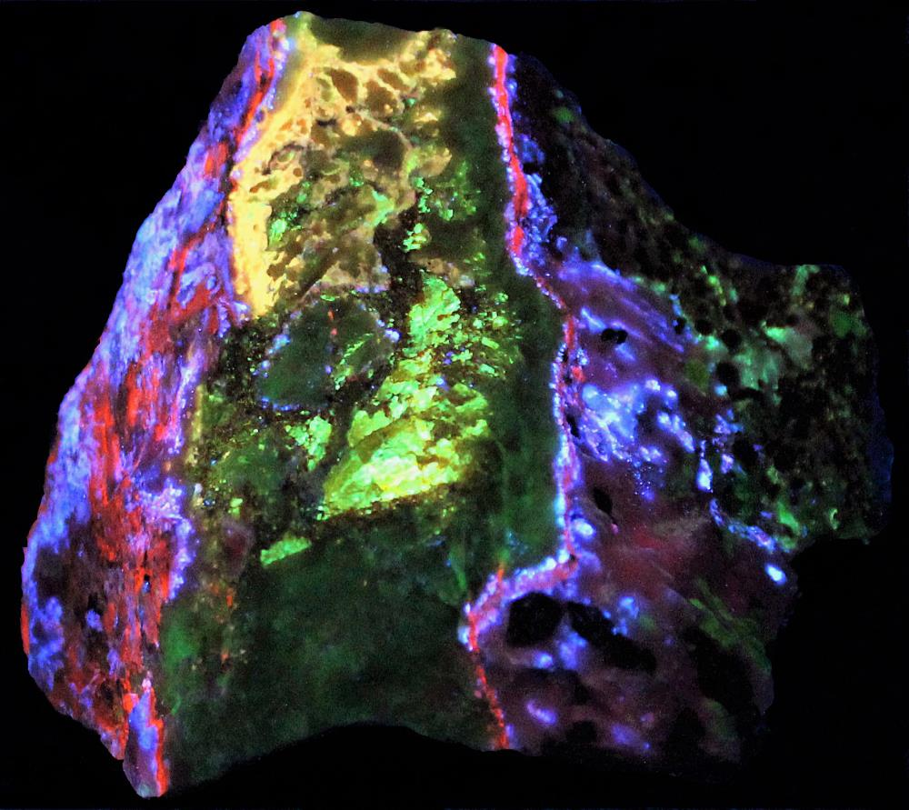 Fluorescent secondary zincite, sphalerite and willemite under longwave UV light.
