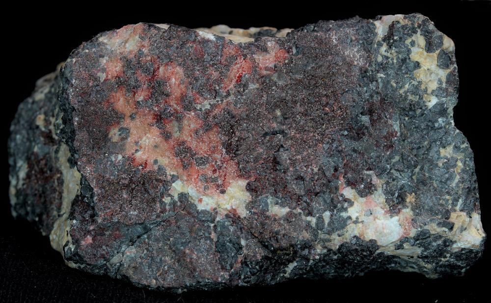 Birnessite, calcite, franklinite, and minor willemite, Sterling Hill Mine, Ogdensburg, NJ