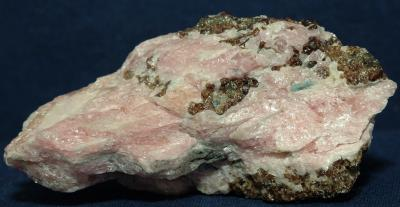 Bustamite, hardystonite, clinohedrite, andradite garnet, willemite and apatite crystal from Franklin, NJ