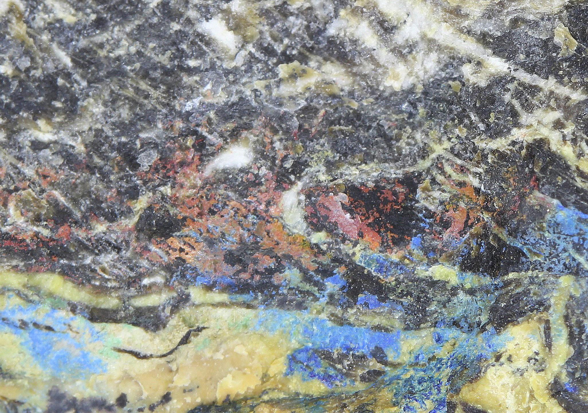 Cuprite, azurite, franklinite and calcite from the Sterling Hill Mine, Ogdensburg, NJ