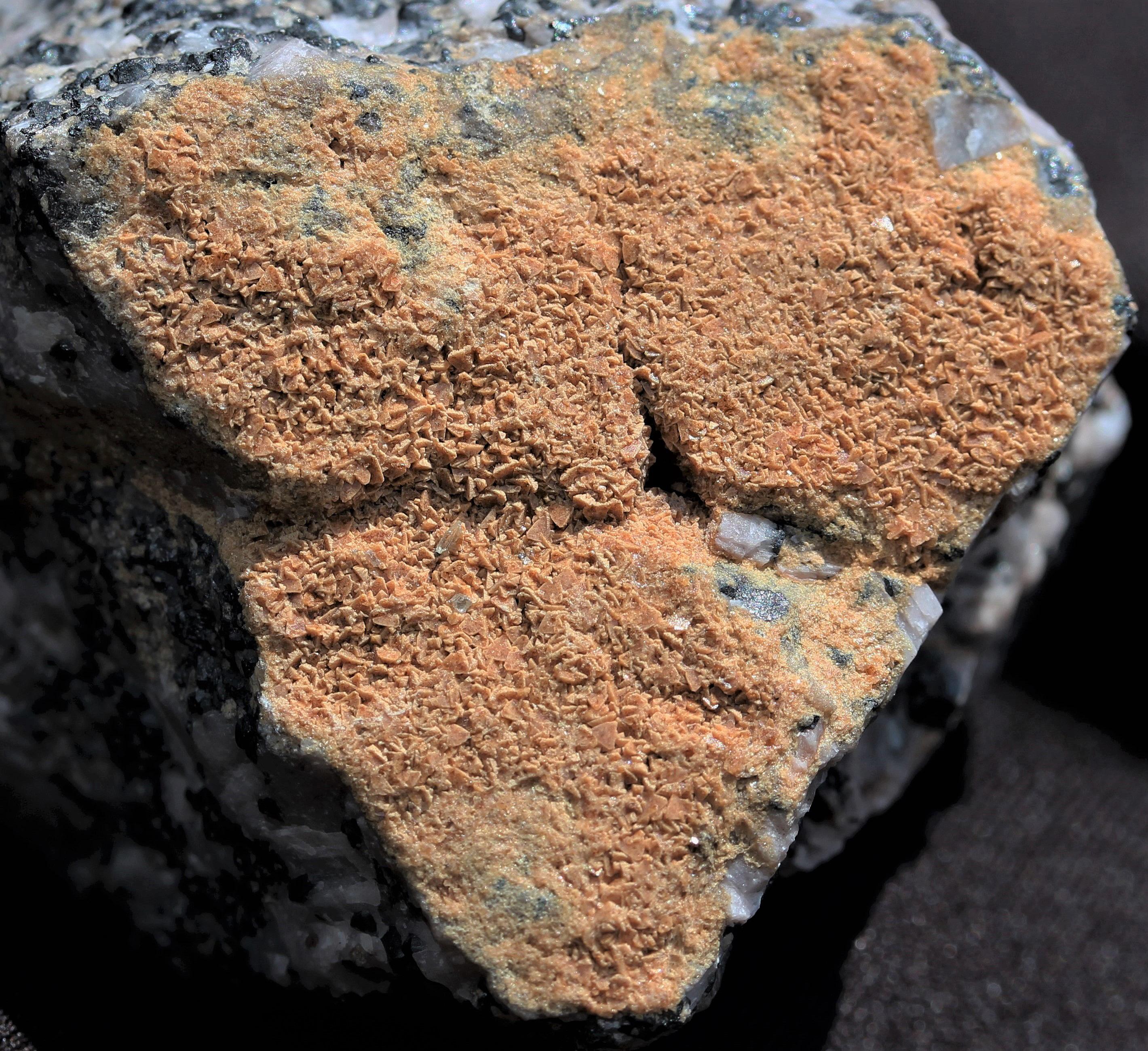 Friedelite crystals on calcite, franklinite matrix from Sterling Hill Mine, Ogdensburg, NJ