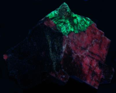 Genthelvite and calcite from the Passaic Pit, Sterling Hill Mine, NJ. under longwave UV Light
