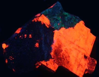 Genthelvite and calcite from the Passaic Pit, Sterling Hill Mine, NJ. under shortwave UV Light