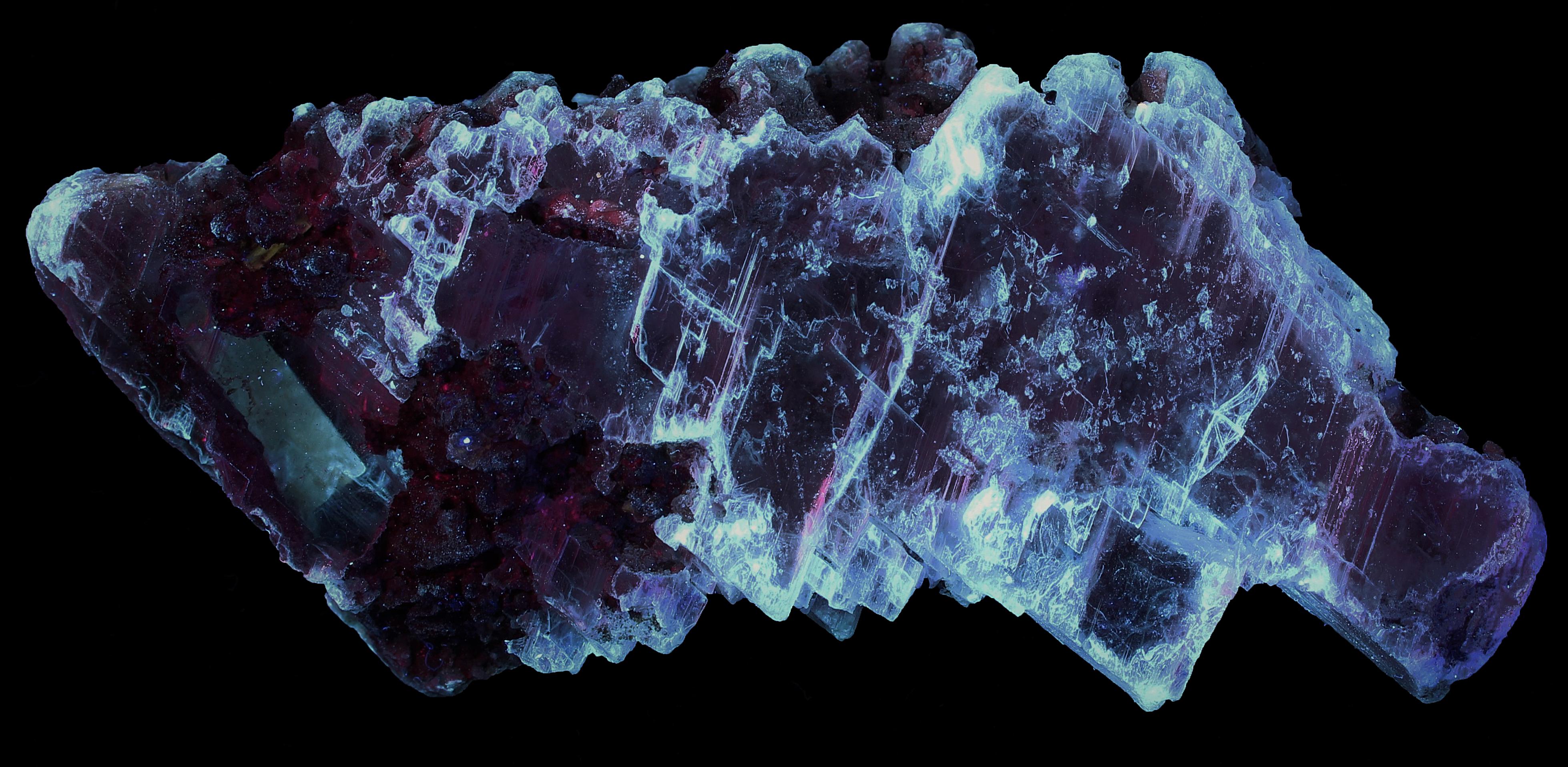 Gypsum (selenite), franklinite and calcite from the Sterling Hill Mine, NJ under longwave UV Light