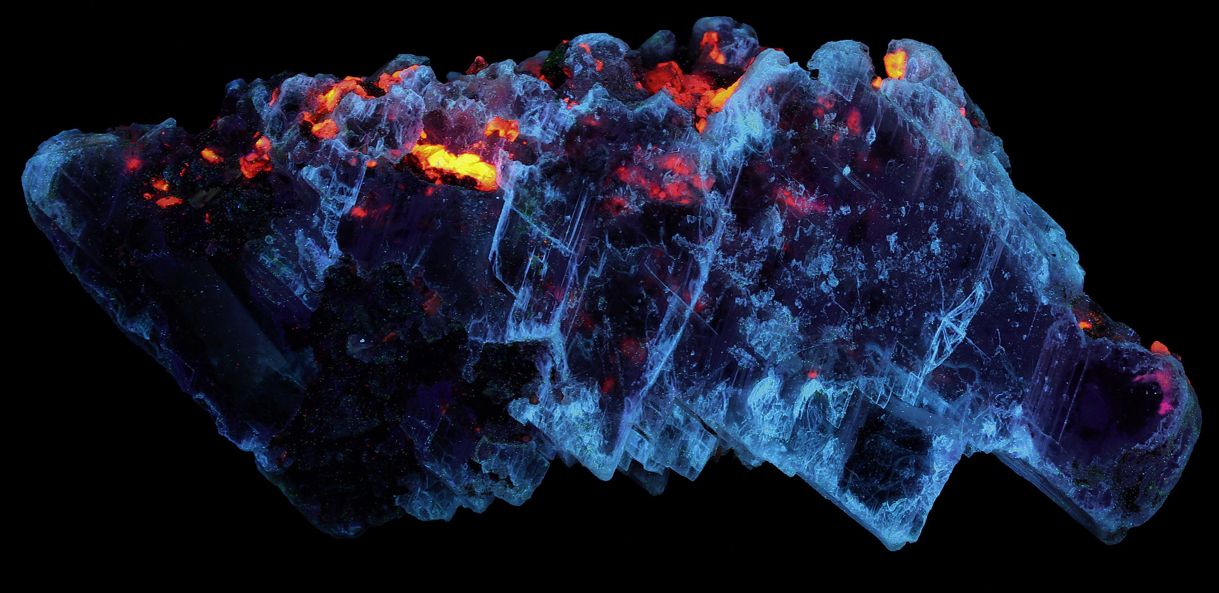 Gypsum (selenite), franklinite and calcite from the Sterling Hill Mine, NJ under shortwave UV Light
