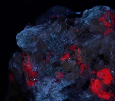 Margarite, calcite, corundum crystals, rutile and minor pyrite from the Sterling Hill Mine, Ogdensburg, NJ under longwave UV Light