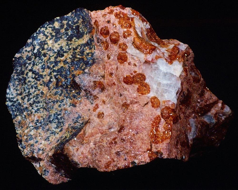 Schallerite (sperules), rhodonite, calcite, willemite and franklinite from Franklin, NJ