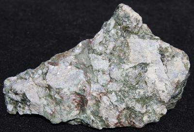 Stilpnomelane, dolomite, calcite, and minor sphalerite, Taylor Road Dump, Franklin, NJ.